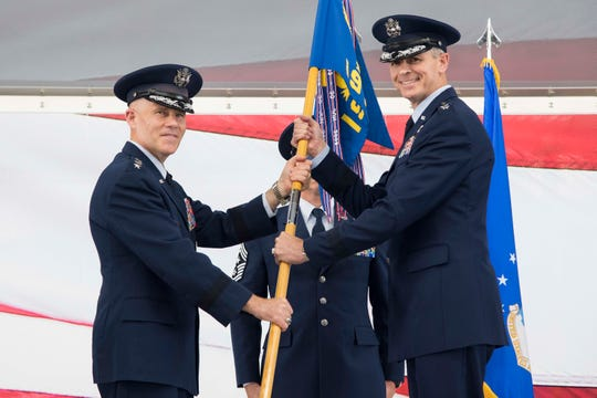 Lt. Gen. Steve Kwast, commander of Air Education and Training Command, passes the 19th Air Force guidon to Maj. Gen. Craig Wills, during the 19th Air Force change of command ceremony June 13, 2019, at Joint Base San Antonio-Randolph, Texas.  Members of the numbered Air Force unit will oversee 19 training locations, with 16 Total Force wings, 10 active duty, one Air Force Reserve and five Air National Guard units.  More than 32,000 members of the 19th Air Force operate more than 1,350 aircraft from 29 different aircraft models. Wills comes to JBSA-Randolph from his previous assignment as the deputy chief of the Office of Security Cooperation-Iraq.