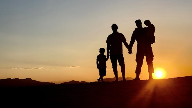 (From right to left) Tech. Sgt. Joshua Chevalier, 49th Maintenance Group weapons contracting officer's representative, poses for a photo with his husband, Ryan Chevalier, and their two children, June 11, 2019, at White Sands National Monument, N.M. The Chevaliers reflected on how the acceptance of lesbian, gay, bisexual and transgender has changed for the better over Joshua's time in service.