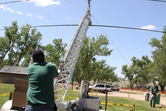 The San Juan County EmComm Team raises the antenna, Saturday, June 22, 2019, in Riverside Park in Aztec.