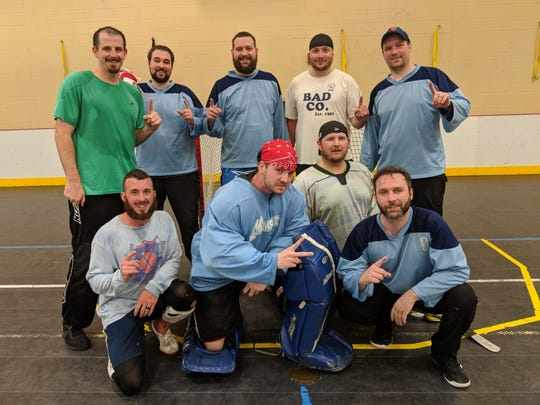 "The Junkyard Dogs repeated as champions of the Michigan Ball Hockey ""A League."" Pictured are, in front, Josh Smith, Zach Nausley, Brian Mortlock and captain Mike Ruff. In back are Bart DeVos, TJ Ruff, Rob Birbeck, Dan Fialon and Dave Majewski."