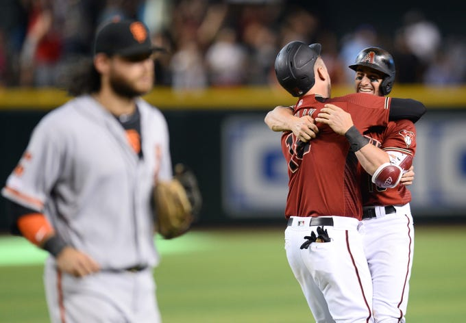 Jun 23, 2019: Arizona Diamondbacks center fielder Tim Locastro (16) celebrates his walk-off RBI single with Arizona Diamondbacks catcher Carson Kelly (18) after the tenth inning as San Francisco Giants shortstop Brandon Crawford (35) leaves the field at Chase Field.