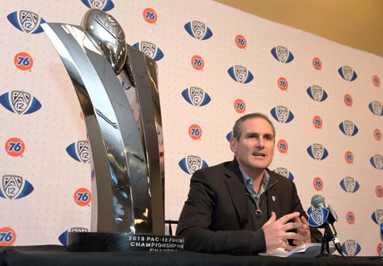 Nov 30, 2018: Pac-12 commissioner Larry Scott addresses the media flanked by the championship trophy at a press conference during the 2018 Pac-12 Championship between the Washington Huskies and the Utah Utes at Levi's Stadium.