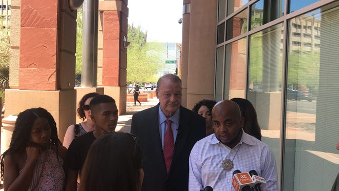 From left to right: Iesha Harper, Dravon Ames, Tom Horne and Jarrett Maupin speak to reporters about their request for city documents outside Phoenix City Hall on June 24, 2019.