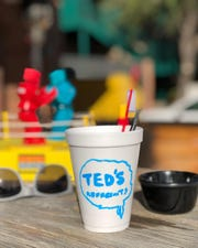 A cup with the Ted's Refreshments logo on it. The new bar is set to open this September.
