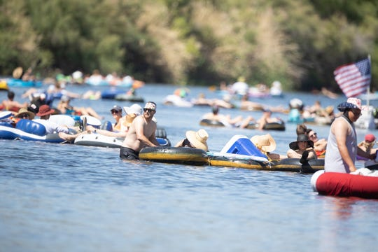 The water was packed with tubers at the Salt River on Saturday, June 22, 2019.