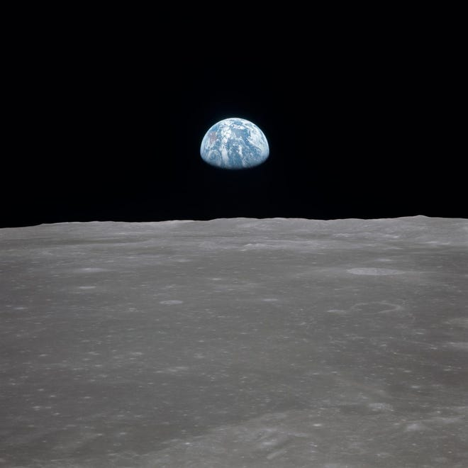 "The famous ""Earthrise"" photo shows the moon with Earth on the horizon. This photo was taken before separation of the lunar module and the command module during Apollo 11 Mission in July 1969."