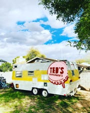 A trailer decked out with the Ted's Refreshments logo. The new bar will have a backyard theme in its back patio.