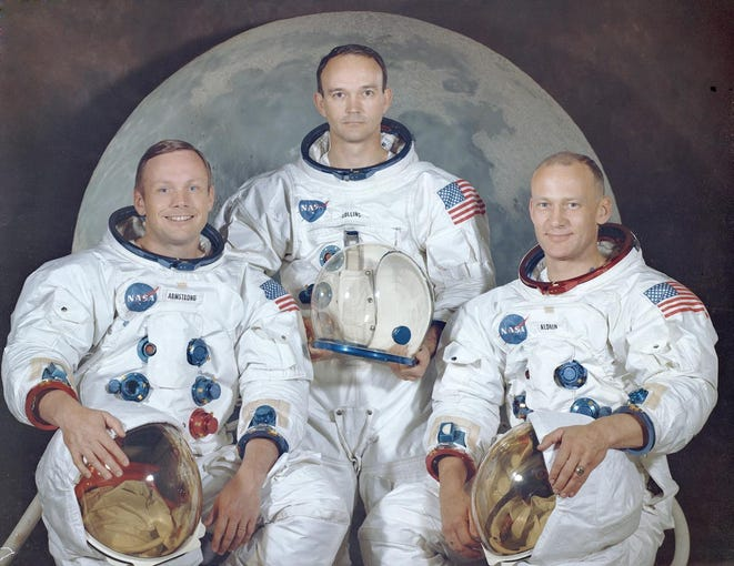 "The official crew portrait of the Apollo 11 astronauts. From left: Commander Neil Armstrong,  Module Pilot Michael Collins and Lunar Module Pilot Edwin E. ""Buzz"" Aldrin. Apollo 11 was the first manned lunar landing mission that placed the humans on the moon and returned them to Earth. Armstrong became the first man to walk on the moon, and Aldrin became the second."