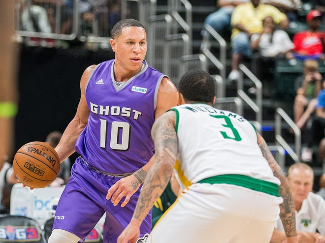 Ghost Ballers' Mike Bibby dribbles the ball while Ball Hogs' Marcus Williams defends in an opening weekend game at Banker's Life Fieldhouse.
