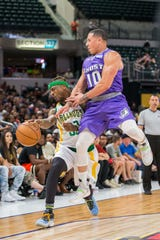 Ghost Ballers' Mike Bibby fouls Ball Hogs' Deshawn Stevenson in an opening weekend game at Banker's Life Fieldhouse.