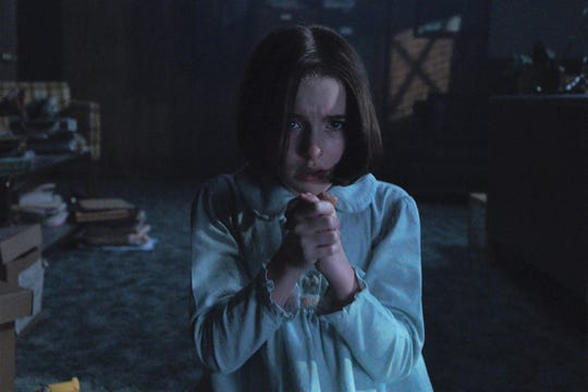"""Judy (Mckenna Grace) prays in """"Annabelle Comes Home."""""""