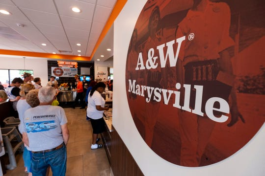 Guests fill the lobby on the opening day of the A&W in Marysville.