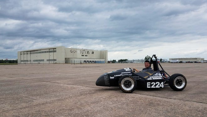 Poughkeepsie's Sean Sheridan takes the electric race car he helped build for a spin during a Formula SAE tournament in Nebraska last week.