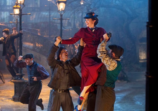 "This image released by Disney shows Emily Blunt as Mary Poppins in ""Mary Poppins Returns."" Free Movies Under the Walkway kicks off the season with a free screening of the Disney film June 29."
