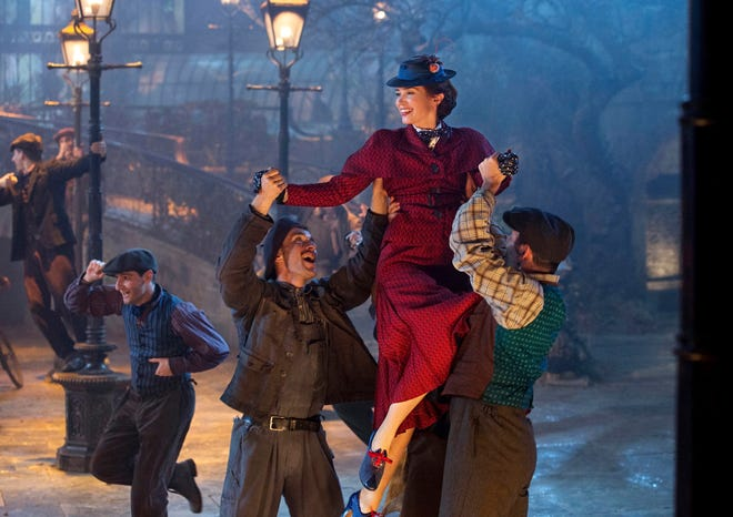 """This image released by Disney shows Emily Blunt as Mary Poppins in """"Mary Poppins Returns."""""""