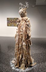 "Roberta Ziemba created a ""Corn Husk Doll"" using corn husks and crystals for his entry in ""Madness in Vegetables."""