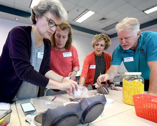 Woodlynde School teacher Susan Van Den Acre, left, and Christine Williams, a Tulpehocken High School teacher, work with Greg and Leigh Foy, right, during the Foy's climate change workshop at Lancaster-Lebanon Intermediate Unit 13 in Lancaster Monday, June 24, 2019. Greg, a York College chemistry professor, and Leigh, a York Suburban High School science teacher, created the workshop geared toward middle and high school teachers. Woodlynde is a K-12 private school in Strafford, Pa. Bill Kalina photo