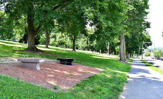 Benches crafted and placed in memory of Lillie Belle Allen, 27, and Patrolman Henry Schaad, the two people who died in the York Riots, are shown on the North Newberry Street side of Farquhar Park in York City, Monday, June 24, 2019. Dawn J. Sagert photo