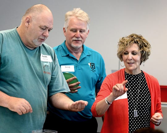 Leigh and Greg Foy work with Palmyra High School teacher Keith Morrow, left, during the couple's climate change workshop at Lancaster-Lebanon Intermediate Unit 13 in Lancaster Monday, June 24, 2019. Greg, a York College chemistry professor, and Leigh, a York Suburban High School science teacher, created the workshop geared toward middle and high school teachers. Bill Kalina photo