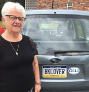 Pat McGrath displays her love of books on her car's license plate.