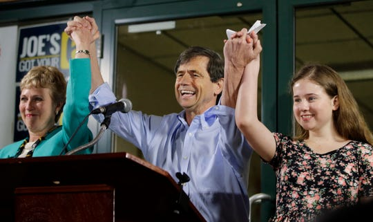 In this April 26, 2016, file photo, former Congressman Joe Sestak, center, his wife Susan Sestak, left, and daughter Alex Sestak react after speaking to supporters gathered outside his campaign headquarters in Media, Pa. Sestak has become the latest Democrat to enter the presidential race.