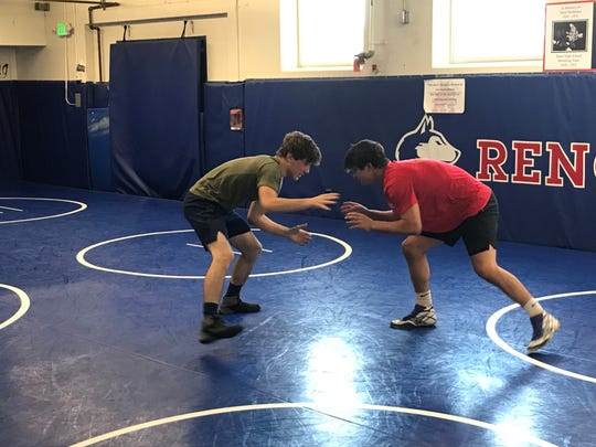 Andrew Berreyesa trains with Aiden Layfield in the Reno High wrestling room last Friday.