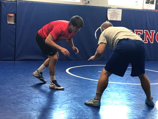 Andrew Berreyesa trains with Steve Howe in the Reno High wrestling room last Friday.