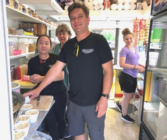 Part of the crew at Redding's popular drive-through hot dog stand: Pichamon Saetoen, left, Glenda Monigold, John Moore and Danielle Dusio.