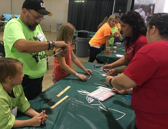 Volunteers help with an activity at the Marion County Fair.