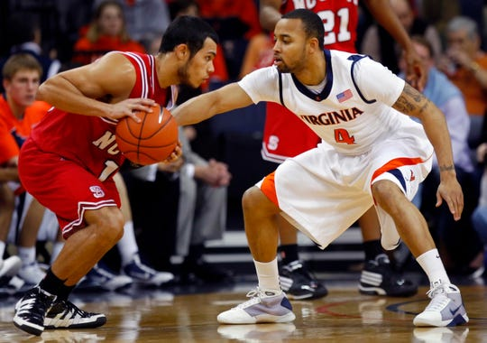 February 3, 2010; Charlottesville, VA, USA; North Carolina State Wolfpack guard Javier Gonzalez (10) handles the ball as Virginia Cavaliers guard Calvin Baker (4) defends at John Paul Jones Arena. The Cavaliers won 59-47. Mandatory Credit: Geoff Burke-USA TODAY Sports.