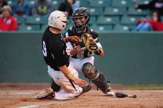 Parkside High School catcher Jack Goertzen tags the plate and looks for an outlet against St. Mikes during the Bayside Championship on Wednesday night.