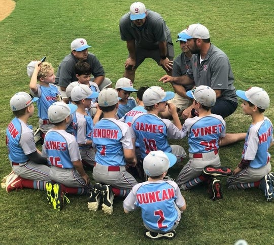 The Shreveport Little League state champions get some coaching instruction.