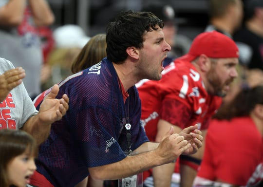 A fan cheers near the end zone during the Sioux Falls Storm game against the Tucson Sugar Skulls in the playoffs Sunday, June 23, at the Denny Sanford Premier Center in Sioux Falls.