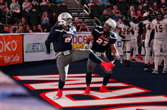 Sioux Falls Storm players Lorenzo Brown and Calen Campbell celebrate after a touchdown during a game against the Tuscon Sugar Skulls in the playoffs Sunday, June 23, at the Denny Sanford Premier Center in Sioux Falls.