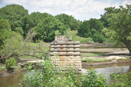 Two limestone columns used to hold the Illinois Central Railroad over the Big Sioux River into East Sioux Falls beginning in 1888. They still wade east of Mary Jo Wegner Arboretum.