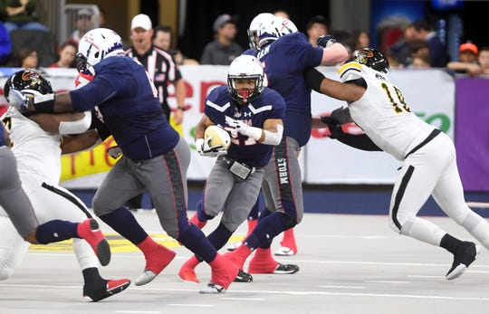 Sioux Falls Storm running back Calen Campbell runs the ball down the field in a game against the Tucson Sugar Skulls in the playoffs Sunday, June 23, at the Denny Sanford Premier Center in Sioux Falls.