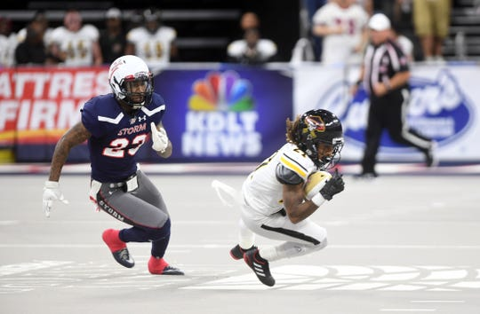 Sioux Falls Storm defensive back Rick Rumph chases Tucson Sugar Skulls wide receiver Jeremiah Harris during their playoff game Sunday, June 23, at the Denny Sanford Premier Center in Sioux Falls.