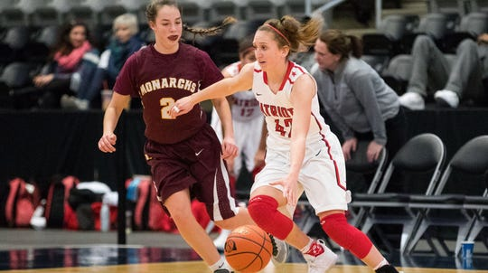 Millard South's Maddie Krull dribbles as Papillion-La Vista's Olivia Boudreau defends on Wednesday, Jan. 3, 2018 during the Metro Holiday Basketball Tournament at Ralston Arena in Ralston, Neb.