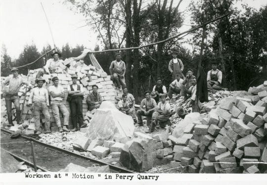 """Workmen at ""Motion"" in Perry Quarry"" circa 1905."