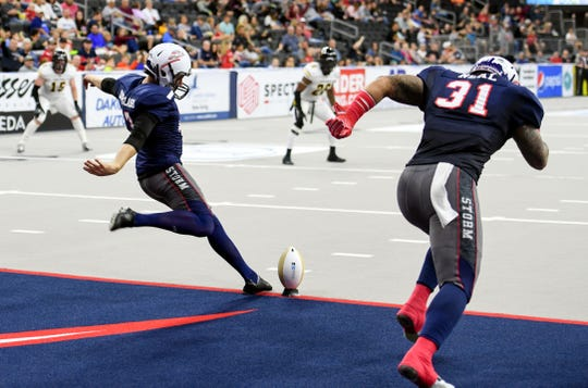 Sioux Falls Storm kicker Parker Douglass punts while linebacker T.J. Neal runs past in a game against the Tucson Sugar Skulls defense in the playoffs Sunday, June 23, at the Denny Sanford Premier Center in Sioux Falls.