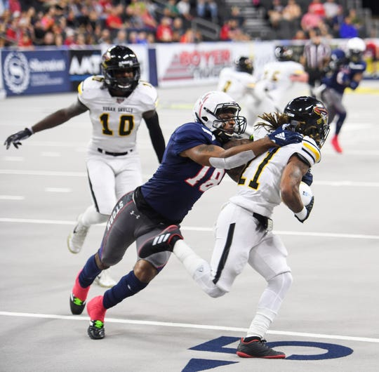 Sioux Falls Storm defensive back Jermaine Robinson tackles Tucson Sugar Skulls wide receiver Jeremiah Harris in the playoffs Sunday, June 23, at the Denny Sanford Premier Center in Sioux Falls.