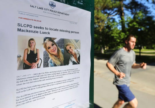 A joggers runs pass a poster of MacKenzie Lueck at Liberty Park Monday, June 24, 2019, in Salt Lake City.