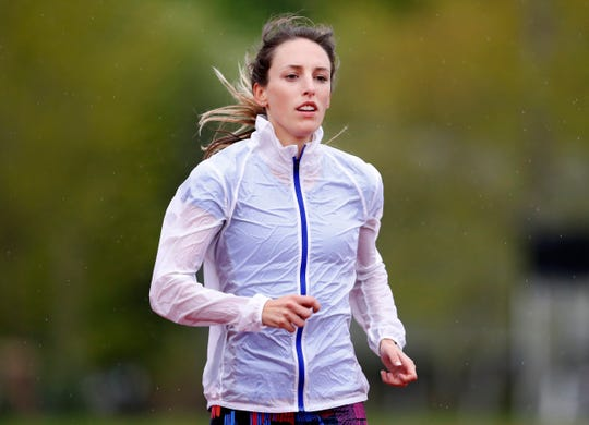 "FILE - In this May 8, 2017, file photo, Gabriele ""Gabe"" Grunewald trains at Macalester College in St. Paul, Minn. Grunewald, one of the country's top middle-distance runners, has died at her home in Minneapolis after inspiring many with a long and public fight against cancer. She was 32. Her husband, Justin Grunewald, posted on Instagram about her death late Tuesday, June 11, 2019, and confirmed it Wednesday in a text to The Associated Press. (Carlos Gonzalez/Star Tribune via AP, File)"