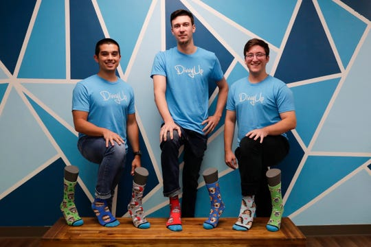 From left: Jason McIntosh, Mitchell Nelson and Spencer Bluni co-founded DivvyUp, a custom sock company, when they were students together in Florida State University's entrepreneurship program in 2014.