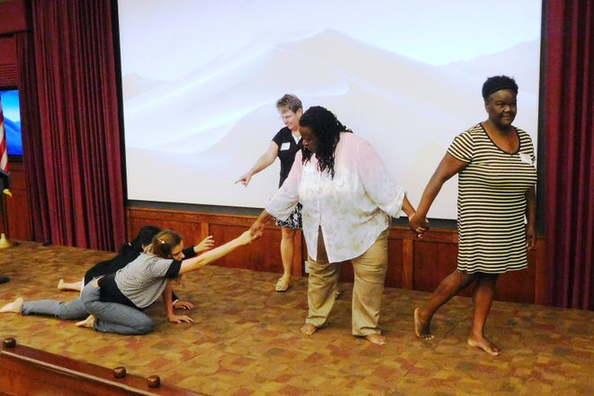 Using no props, costumes, scenery or dialog, teachers convey an essential message through a tableau.