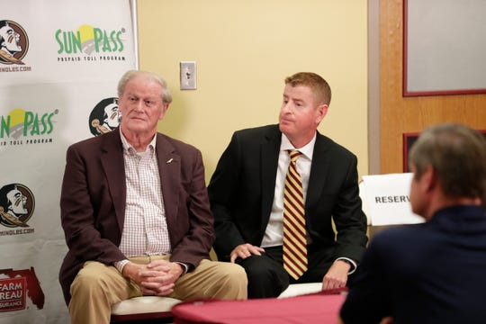 Florida State University President John Thrasher and Mike Martin Jr. listen as Athletic Director David Coburn speaks at a press conference held to officially announce Martin as the next head baseball coach for FSU Monday, June 24, 2019.