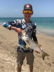 Zavian Smith, 11, of Kentucky  caught and released his first snook Friday fishing at Jensen Beach with a live pilchard.