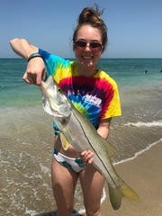 Amelia Smith, 15, of Kentucky, caught and released her first snook at Jensen Beach Friday fishing with a live pilchard.