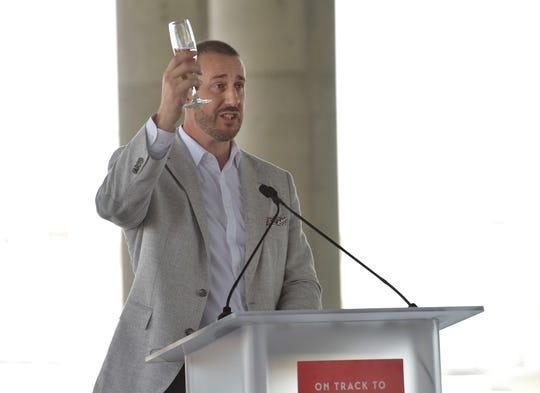 President of Virgin Trains USA Patrick Goddard, raises a glass of champagne for a toast to the kickoff of construction for the expansion of passenger rail service to Orlando from south Florida during their groundbreaking ceremony on Monday, June 24, 2019, at the Orlando International Airport.