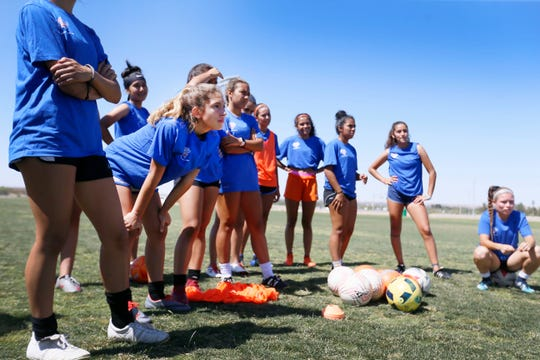 The El Paso Rage FC U18 girls soccer team listens to NMSU graduate assistant Megan Burke explain the next drill during practice Monday, June 24, 2019, at the West Side Soccer Complex in El Paso. The team is going to the National Presidents Cup in Murfreesboro, Tennessee, in July.
